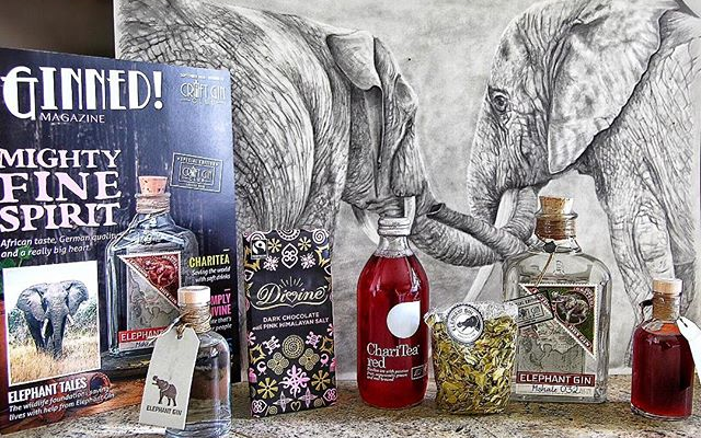 Member Becky Wilson's elephant art serves as the perfect backdrop for her Gin Box.