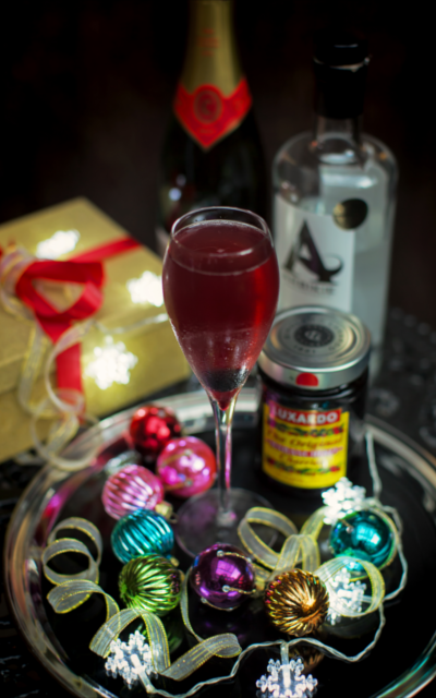 Modern art Arbikie cocktail with luxardo cherries and christmas accessories