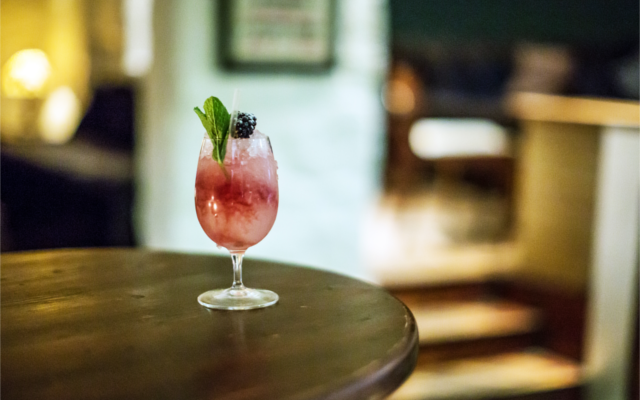 Signature cocktail gin bramble with mint and blackberry