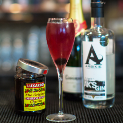 Modern art luxardo cherries arbikie gin and fizz cocktail