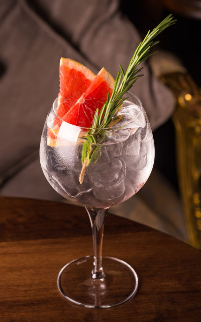 Gin and Tonic Perfect pink grapefruit and rosemary garnish