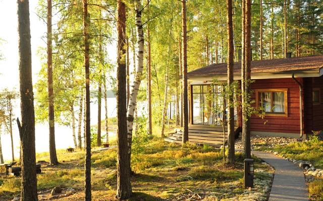 Summer log lodge cabin by the lake in the forrest