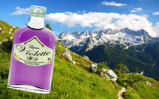 Liqueur de violette creme minature with mountains in backgrounds