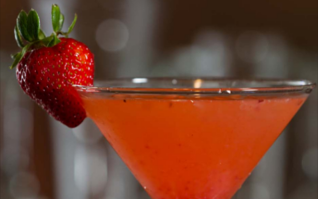 Red strawberry cocktail with strawberry garnish