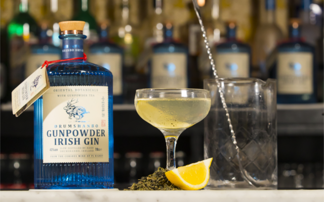Gunpowder Irish Gin cocktail on a bar with lemon garnish