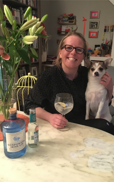 March cross word winner with g and t bouquet of lillies and jack russell dog on lap