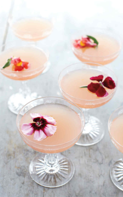 Lillet pink rose spring cocktail with edible flowers to garnish