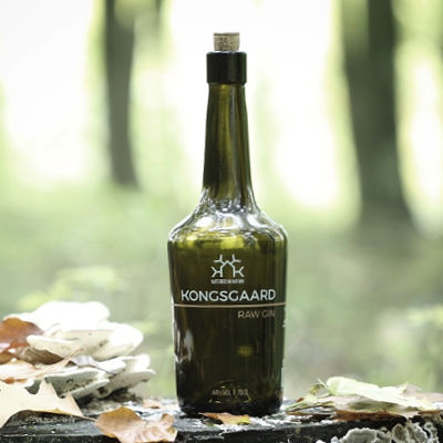 Kongsgaard Gin bottle in forest