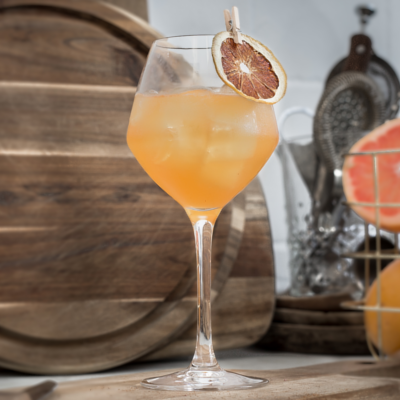 Kongsgaard Gin Root to Fruit Cocktail garnished with orange slice