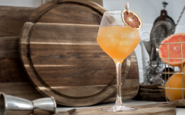 Kongsgaard Gin Root to Fruit cocktail with orange garnish
