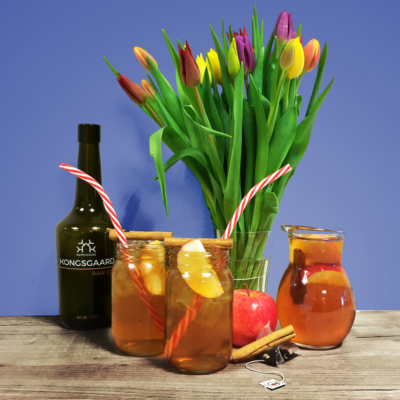 Danish Double Apple Iced Tea with Kongsgaard Gin with Tulips in a Vase and jug of the cocktail