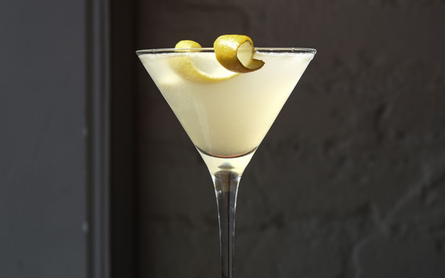 Gin Sour white cocktail with lemon zest twist garnish