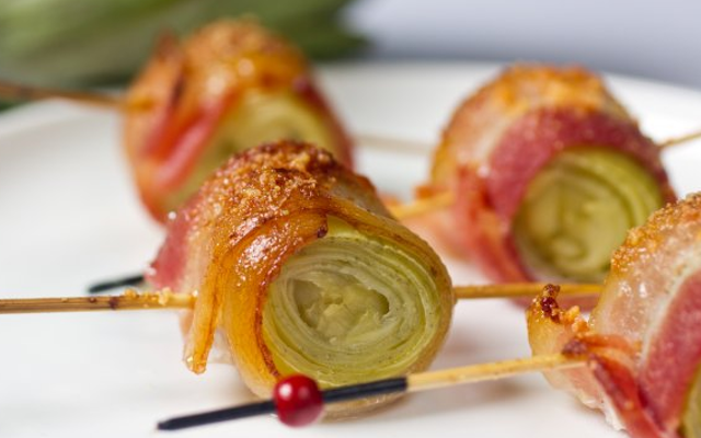 Delicious bacon wrapped artichoke hearts on skewers