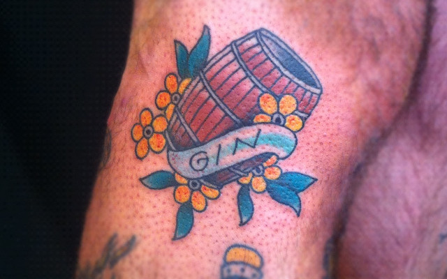 Barrel of gin and flowers tattoo