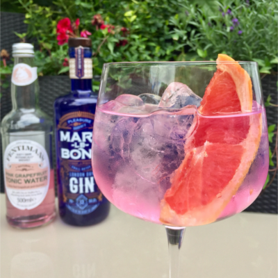 Marylebone Gin and Fentimans Pink Grapefruit Tonic Water Gin and Tonic with wedge of grapefruit over ice
