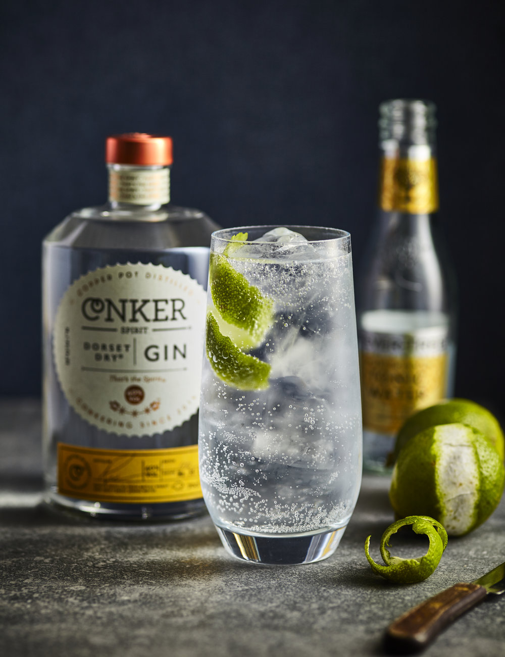 conker gin and tonic with lime peel twist garnish