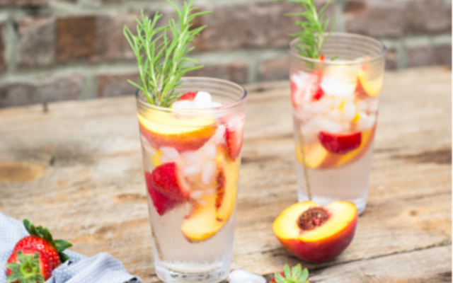 Gin and tonic with peach and rosemary