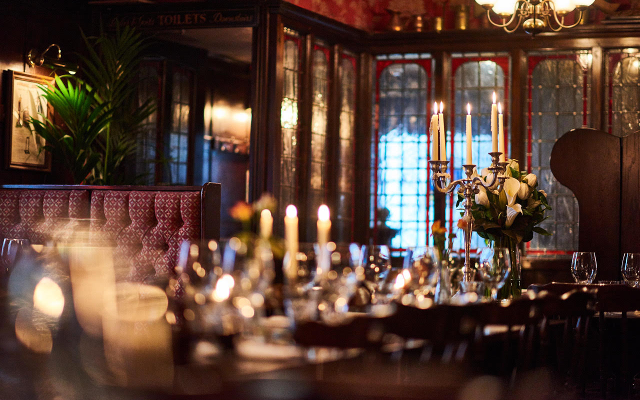 Inside the ship tavern pub in london with candles and glasswear