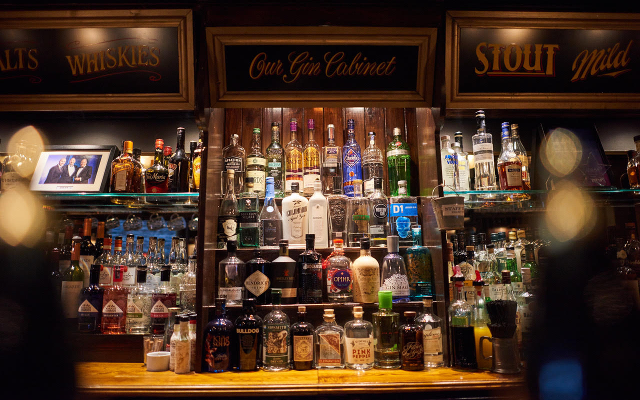 The gin cabinet at the Ship Tavern pub in London