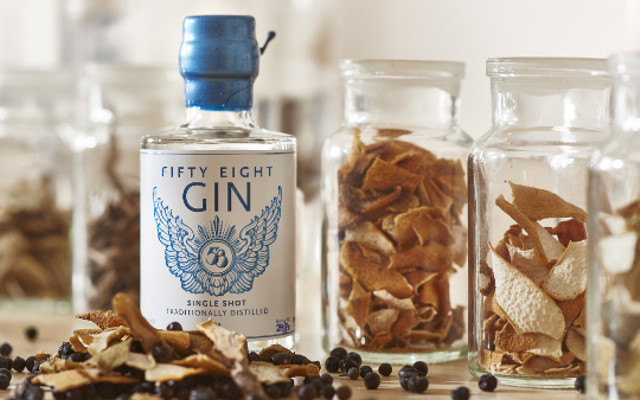 58 Gin surrounded by botanicals