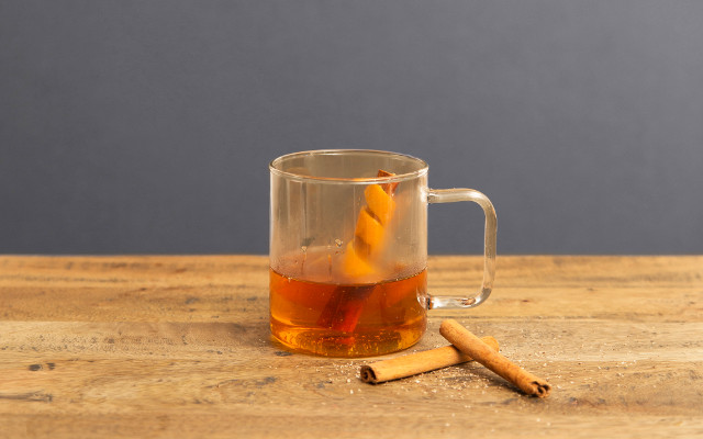 Hackney Homebrew gin cocktail with cinnamon sticks and orange peel