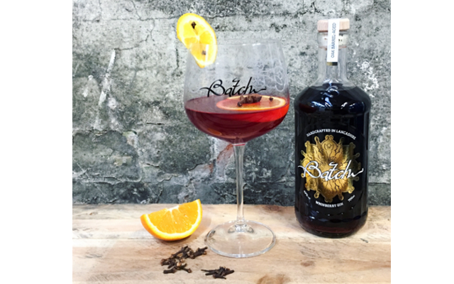 Whinberry gin winter warmer cocktail with orange and cloves