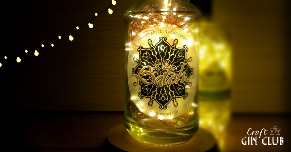 With a bit of DIY, you can transform your gin collection into beautiful, fairy light-filled decorations that will glimmer this Christmas and beyond.