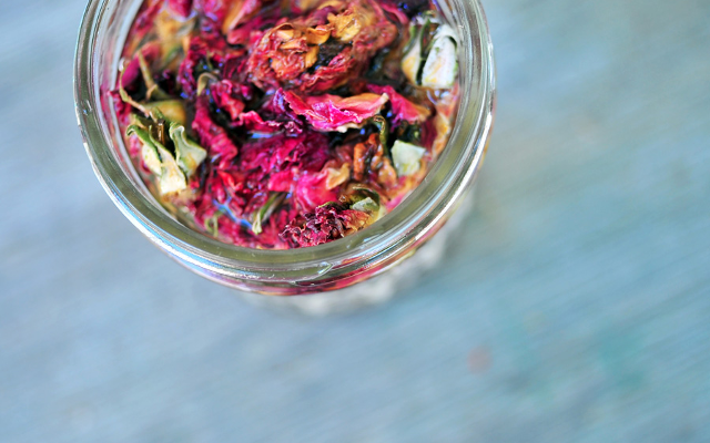 Rose petal and bud infused gin in a jar