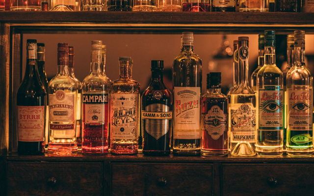 Behind bar liquor bottles at Doctor Inks Curiosities Exeter