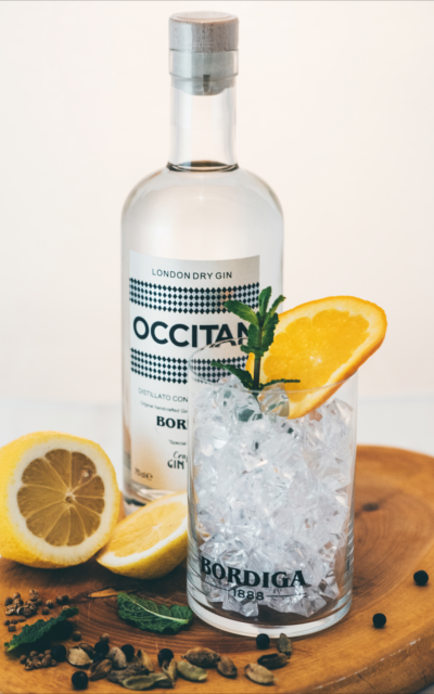Occitan Gin bottle and ice tumbler
