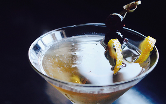 gin martini with olives and lemon twist