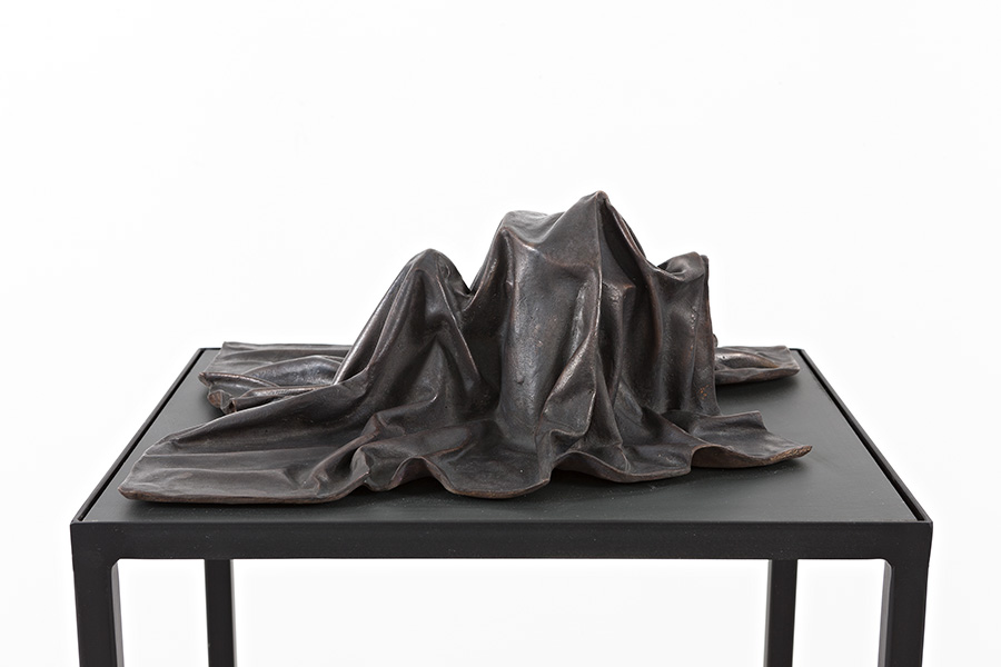Silent Codes III (2015) Bronze on steel and mdf table.  Sculpture: 15 x 33 x 40 cm, table: 100 x 44 x 37 cm.