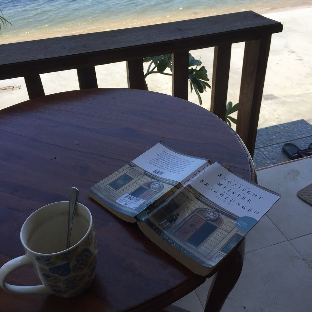 Me reading a bilingual book in my holidays in Lombok, Indonesia in 2015. Do what you preach!
