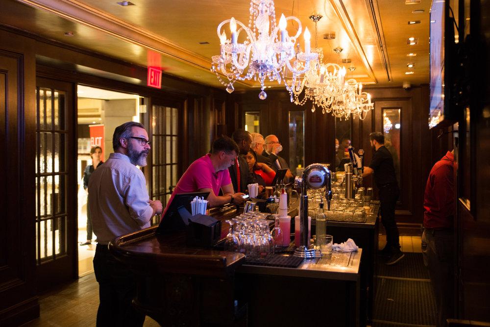 Peter Drew et al at the bar.jpg