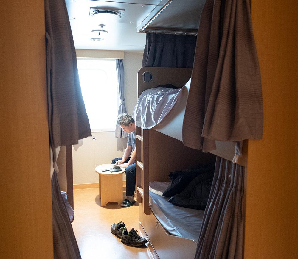 Dans une cabine de la classe affaires, seulement 4 lits plutôt que 8 !