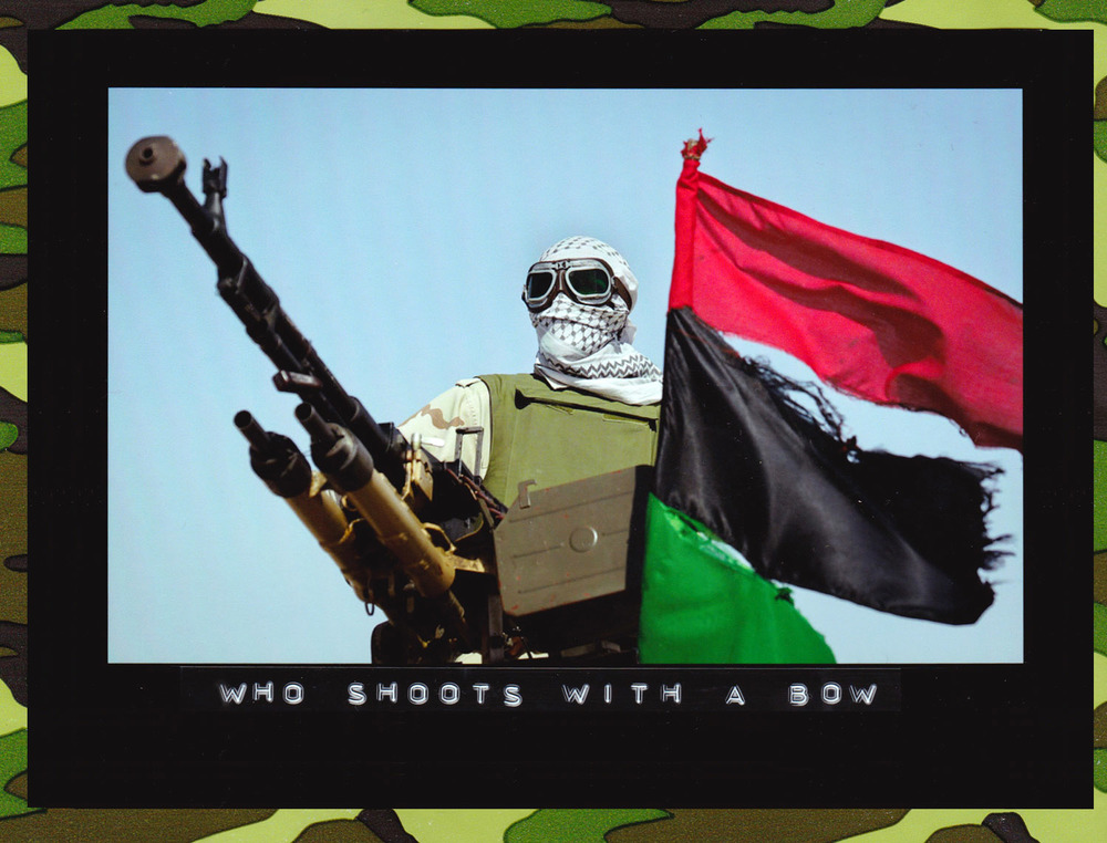 A rebel fighter mans an antiaircraft gun, next to an opposition flag, in the desert on the outskirts of Ajdabiya, Libya, 2011. (Photo: Ben Curtis/Associated Press)
