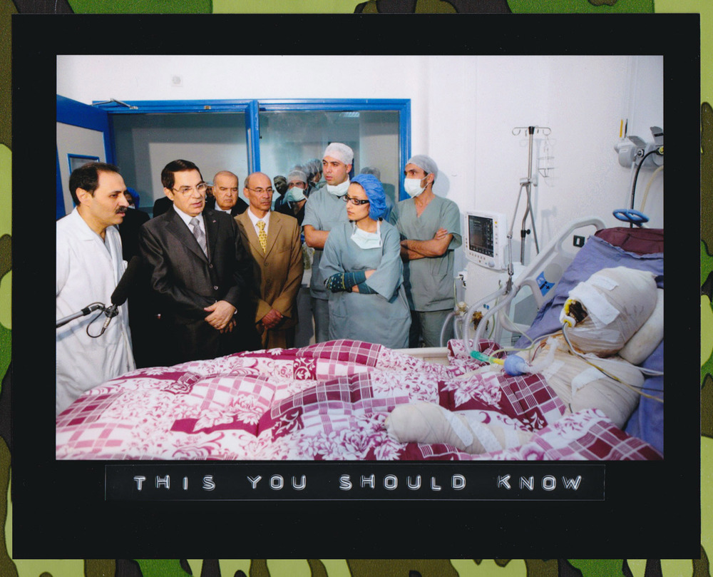 Tunisian President Zine El-Abidine Ben Ali (second left) visits Mohamed Al Bouazzizi (right) at the hospital in Ben Arous near Tunis on December 28, 2010. (Photo: Handout from Tunisian Presidency of Zine El-Abidine Ben Ali/Getty Images)