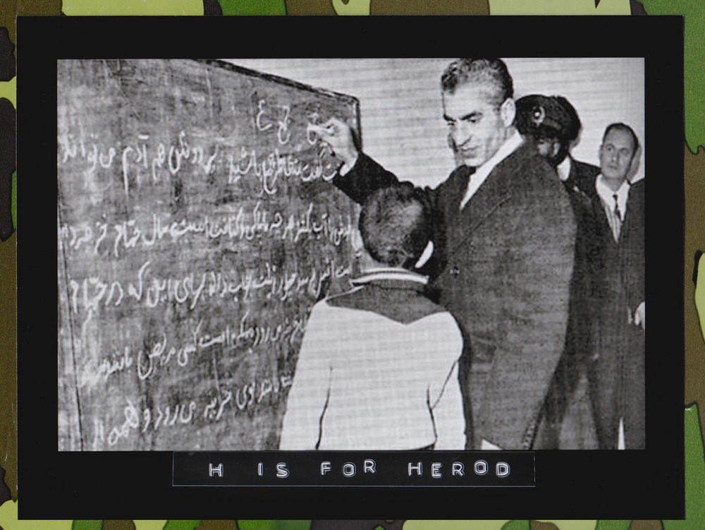 Mohammad Rezā Shāh Pahlavi, Shah of Iran, teaches Farsi to a youth. (Photographer: Unknown)