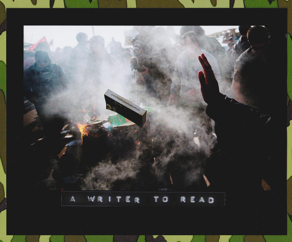 A group of Benghazi citizens gather to burn hundreds of copies of Colonel Muammar Gaddafi's 'Green Book' near the court in Benghazi, Libya, 02 April 2011. The Green Book is a manual outlining the political strategy and philosophy of Libyan leader Gaddafi, and is a symbol of his 42-year rule which rebels fought to overthrow. (Photo: Manu Brabo/Associated Press)