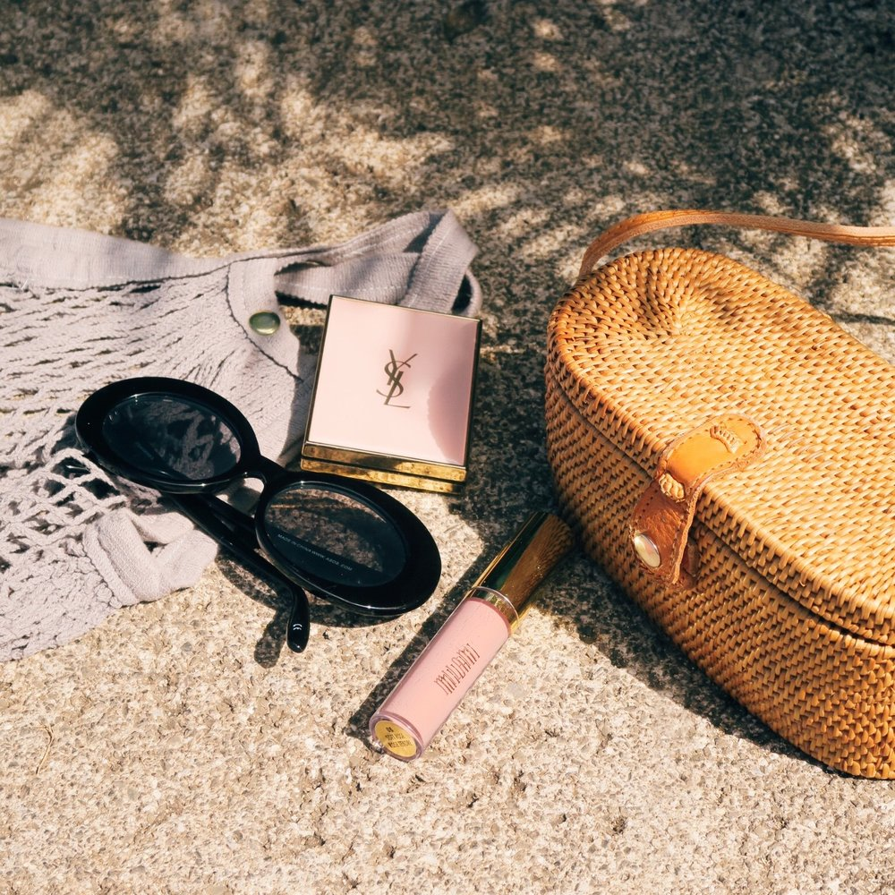 Island essentials –  Clare V Netty bag ,  Asos Oval Sunglasses ,  YSL Touche Eclat Blur Perfector ,  Milani Lip Plumper in Soft Rose ,  Faithfull the Brand Camila Bag