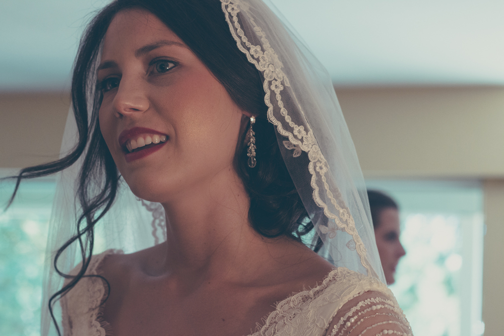 Bride getting ready wearing veil at Rockwater Secret cove elopement and wedding spot
