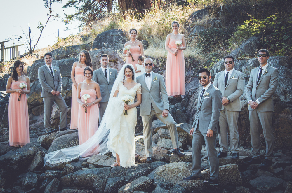 Bridal party standing on rocks at Rockwater Secret cove elopement and wedding spot