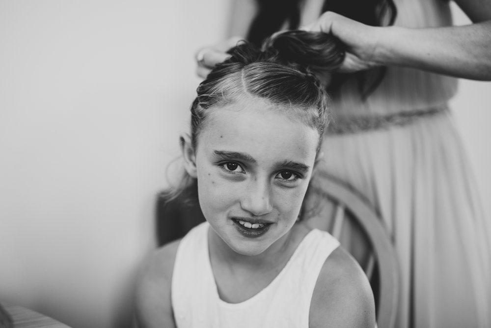 Flower girl getting hair finished for Starling Lane Winery wedding