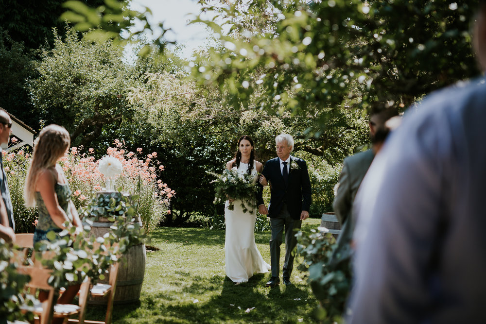 Bride walking down aisle with father at Starling Lane winery