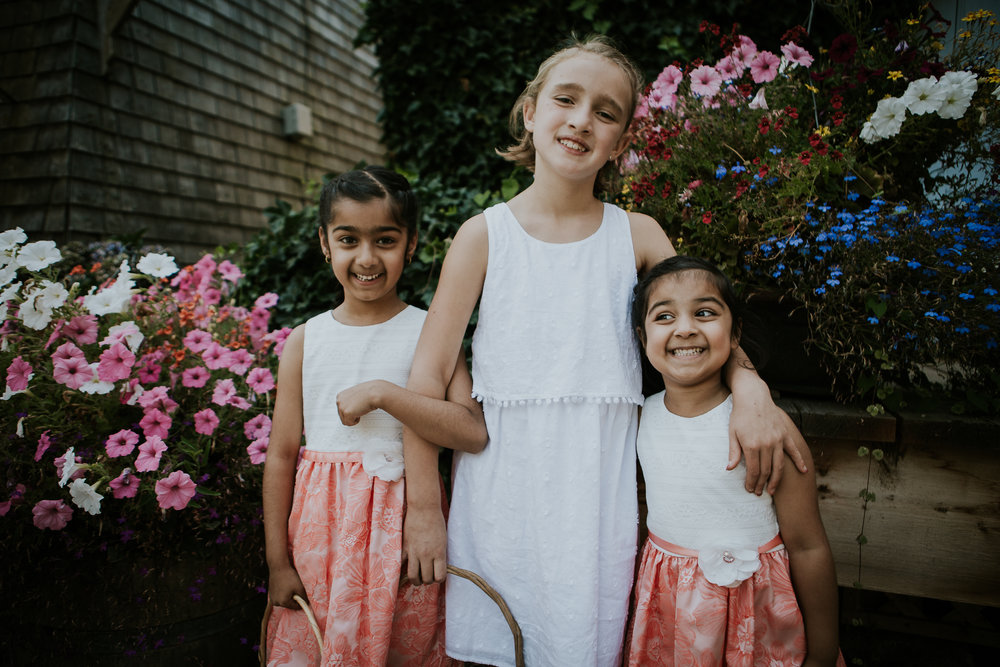 Flower girls smiling for camera among flowers at Starling lane winery wedding