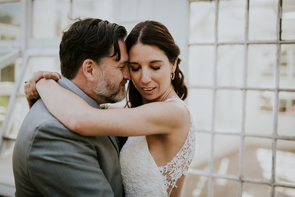 Bride and groom at greenhouse for wedding photos in Victoria BC