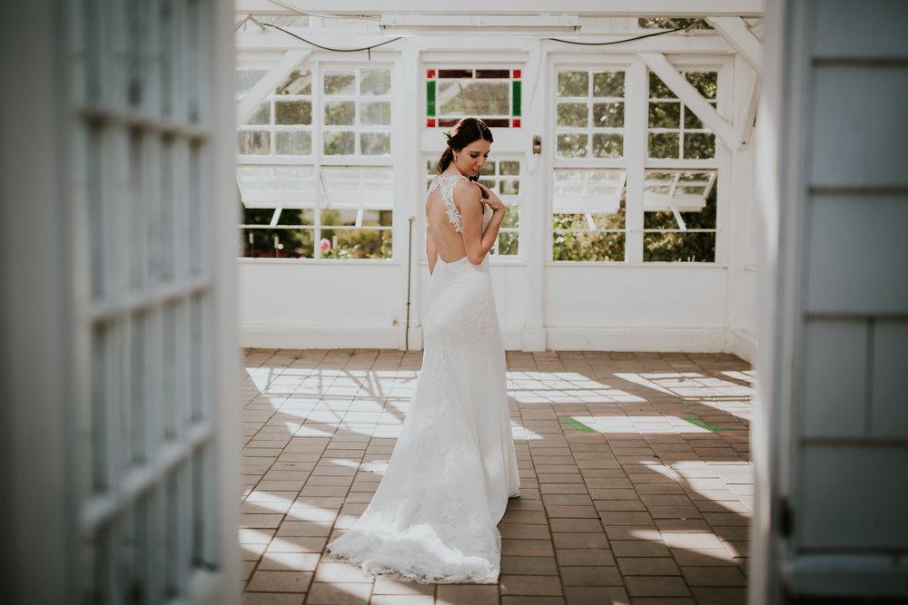 Bride inside greenhouse for wedding photos near Victoria BC Vancouver Island