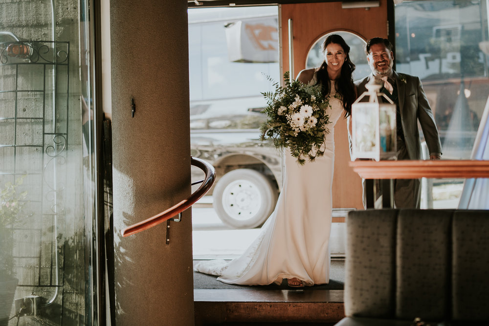 Bride and groom arriving at wedding reception venue in Inner Harbour Victoria Bc