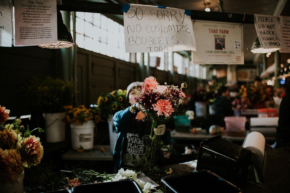 Woman selling fresh flowers at Seattle Public Market