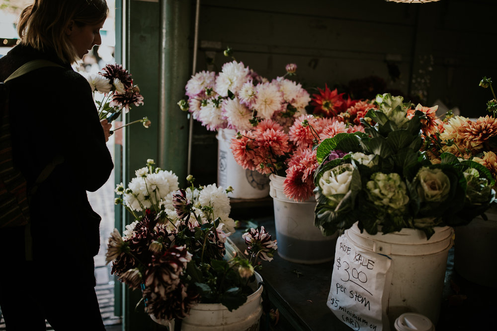 Girl picking flowers for bridal bouquet at Seattle Public Market